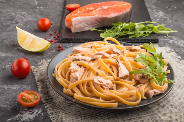 Semolina pasta with salmon and salmon steak. side view, close up