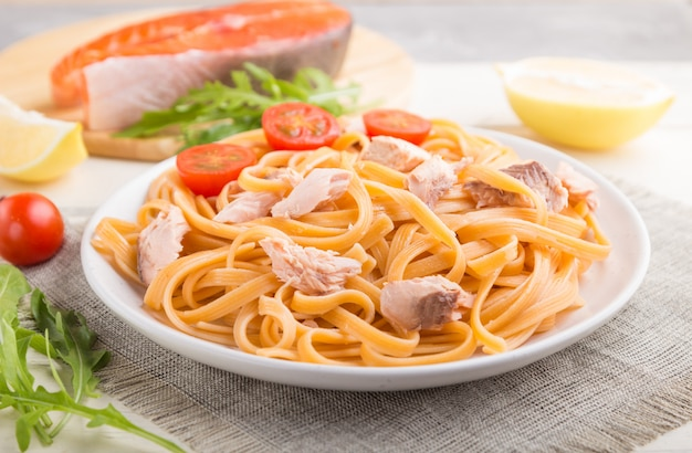 Semolina pasta with salmon and salmon steak. side view