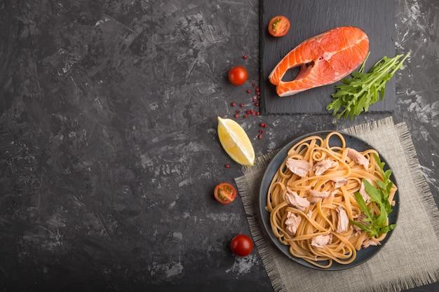 Semolina pasta with salmon and salmon steak. top view, copyspace.