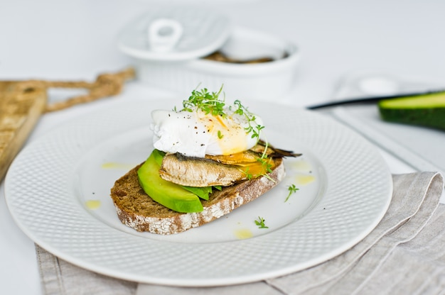 Sen with avocado, poached egg and sprats.