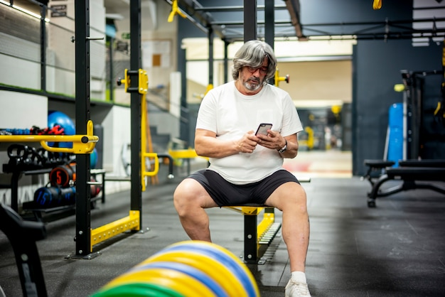 Senior adult man doing sports in the gym.