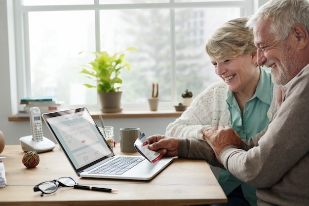 Senior adult tablet insurance plan concept