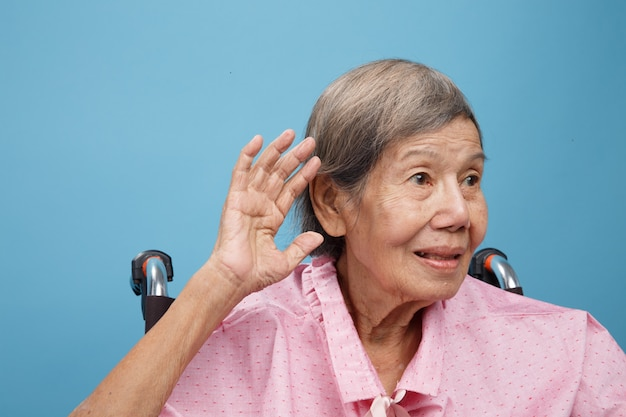 Senior adult woman hearing loss , hard of hearing