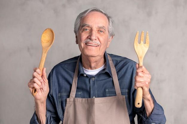 Senior american man wearing an apron