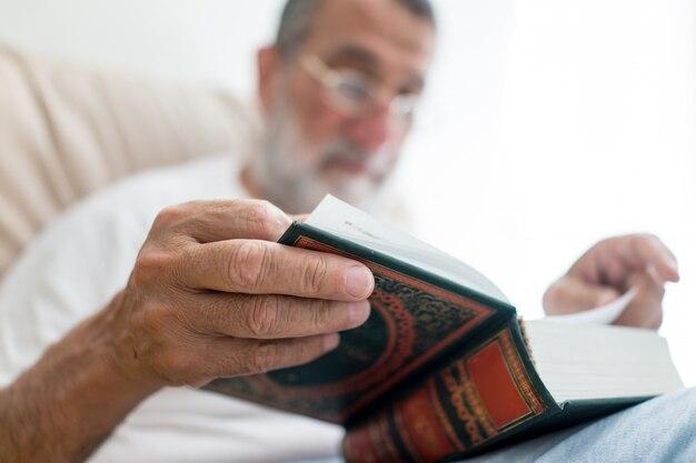 Senior arabic man reading book