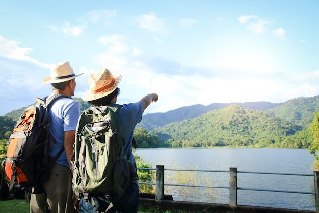 Senior asian couple trekking, traveling, living a happy life in retirement healthy