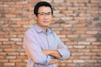 Senior Asian Man Standing with Arms Crossed
