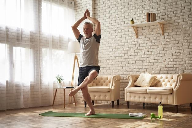 Senior athlete does exercises.