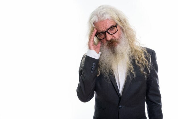 Senior bearded businessman looking stressed
