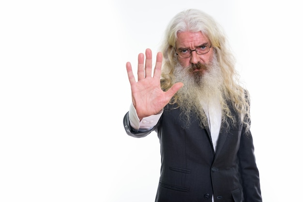 Senior bearded businessman showing stop hand sign