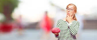 Senior beautiful woman with a brain model