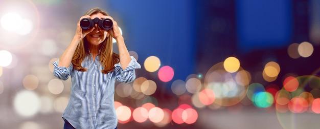 Senior beautiful woman with binoculars