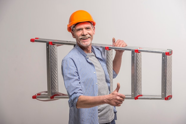 Senior builder holding stairs