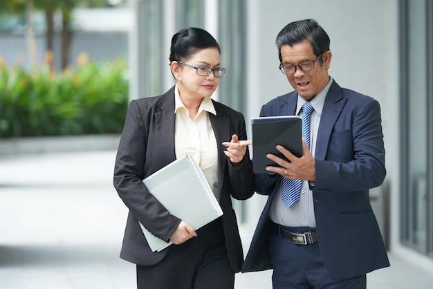 Senior business couple talking