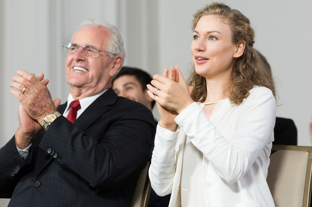 Senior business man clapping with a woman