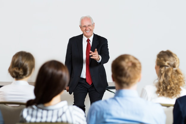 Senior business man giving a lecture Free Photo
