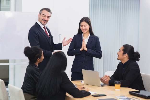 Senior business man introduce woman to other colleague