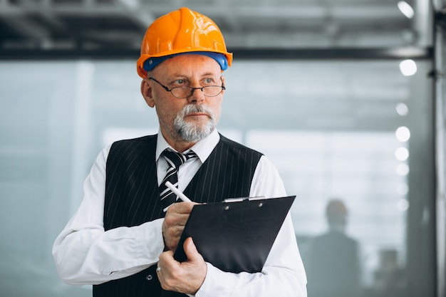 Senior businessman architect in a hard hat
