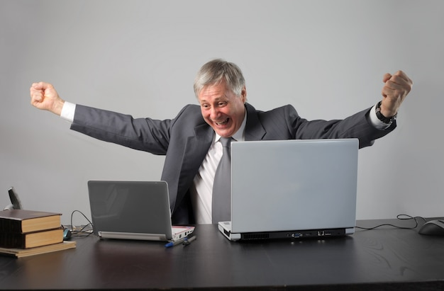 Senior businessman cheering