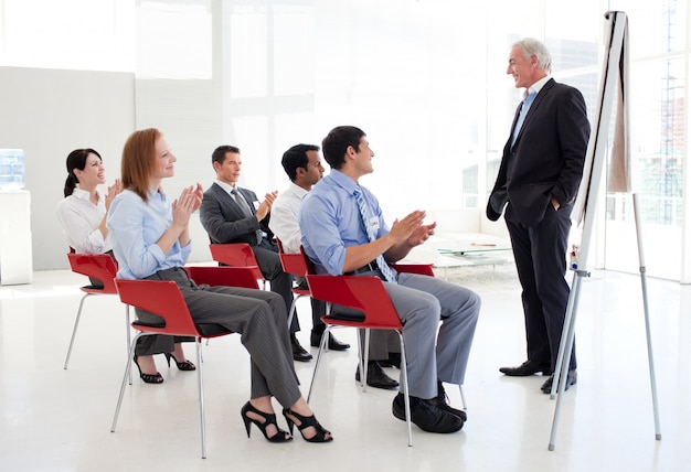 Senior businessman giving a conference