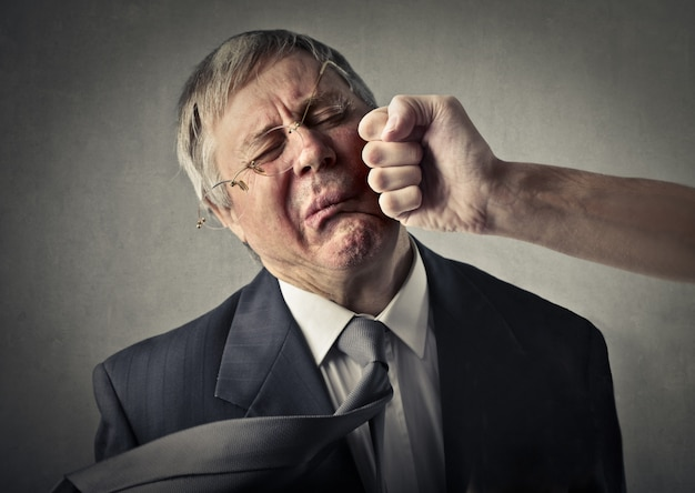 Senior businessman punched in the face