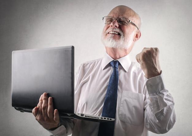 Senior businessman reaching a goal