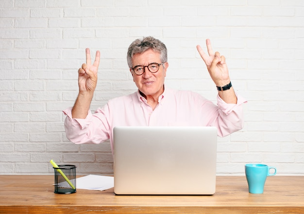 Senior businessman singing rock, dancing, shouting, gesturing in a rebellious, angry way.