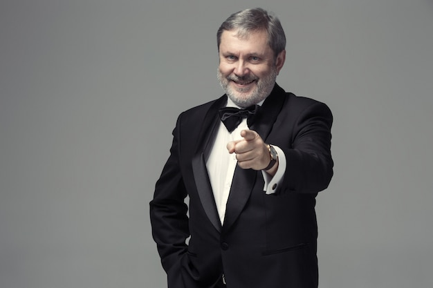 Senior businessman standing and pointing