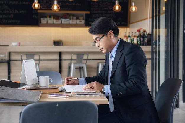 Senior businessman working at coffee shop