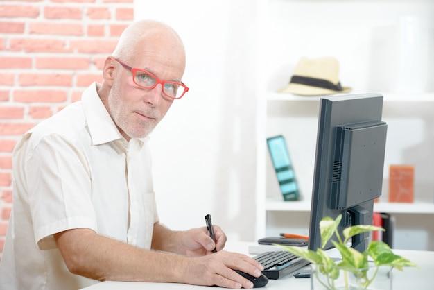 Senior businessman working on  computer
