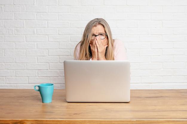 Senior businesswoman coughing, suffering a winter illness