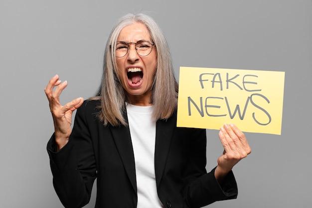 Senior businesswoman with fake news banner