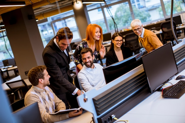 Senior businesswoman and young business people work in a modern office