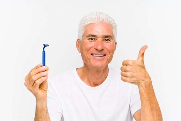 Senior caucasian man holding a razor blade