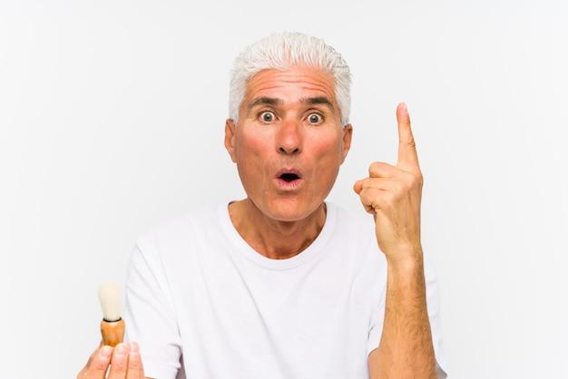 Senior caucasian man recently shaved having some great idea, concept of creativity.