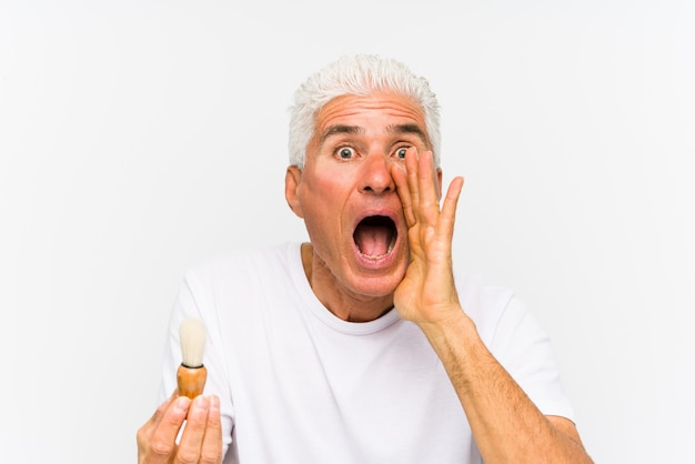 Senior caucasian man recently shaved shouting excited to front.
