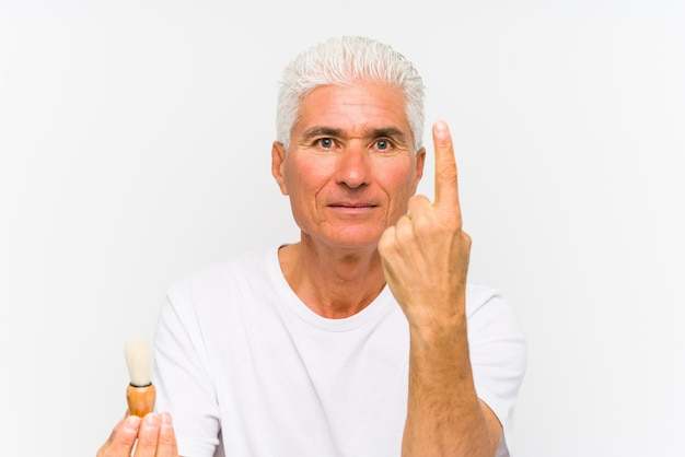 Senior caucasian man recently shaved showing number one with finger.