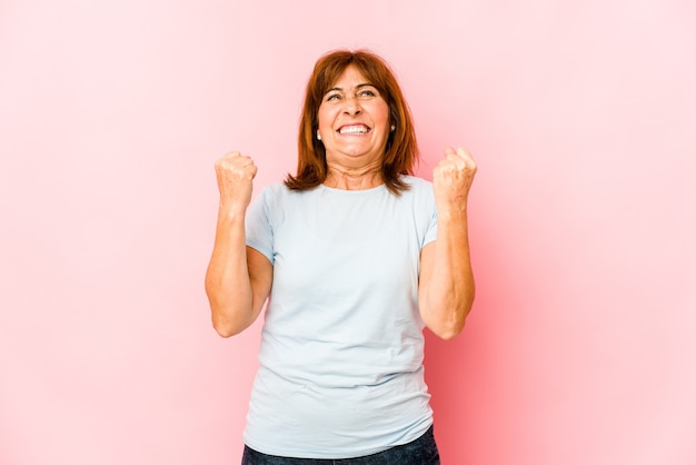 Senior caucasian woman isolated celebrating a victory, passion and enthusiasm, happy expression.