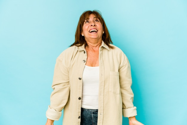 Senior caucasian woman isolated shouting very angry, rage concept, frustrated.