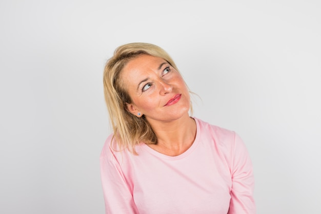 Senior charming woman in rose blouse