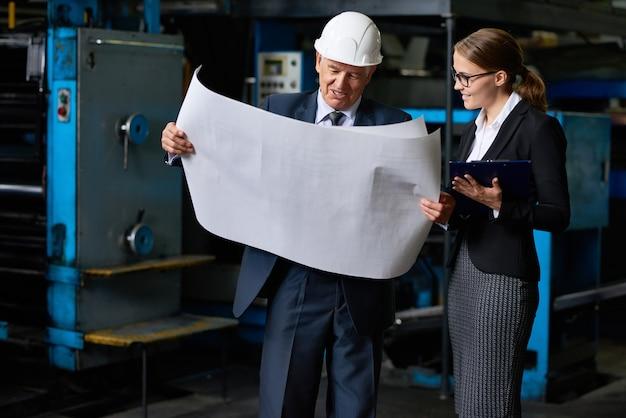 Senior construction inspector proofing factory plans