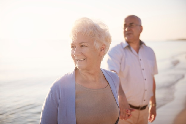Senior couple in the beach, retirement and summer vacation concept