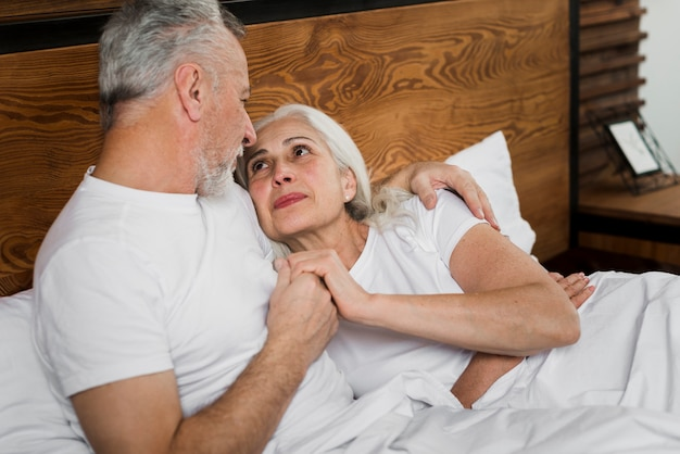 Senior couple on bed on valentines day