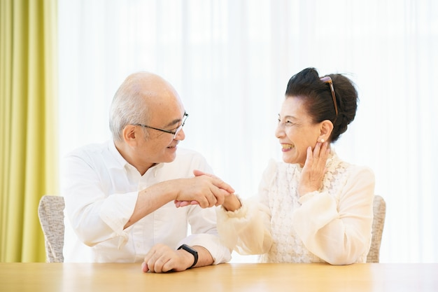 Senior couple chatting with smile in the living room