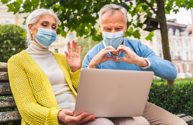 Senior couple communicating in remote with relatives and parents during pandemic quarantine