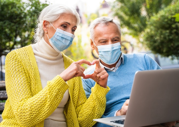 Senior couple communicating in remote with relatives and parents during pandemic