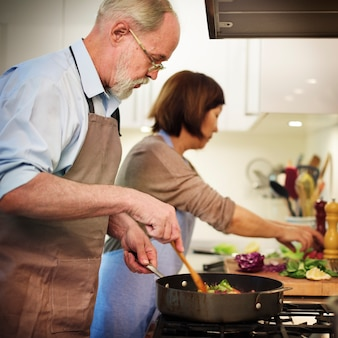 Senior couple cooking together in the kitchen