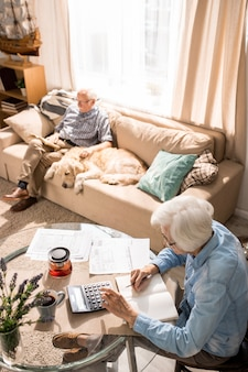 Senior couple counting budget