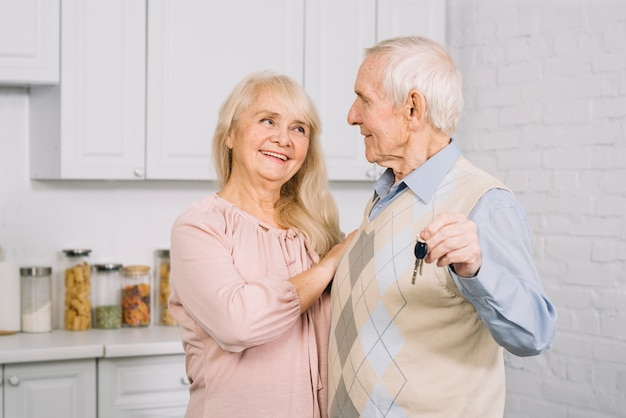 Senior couple dancing in kitchen