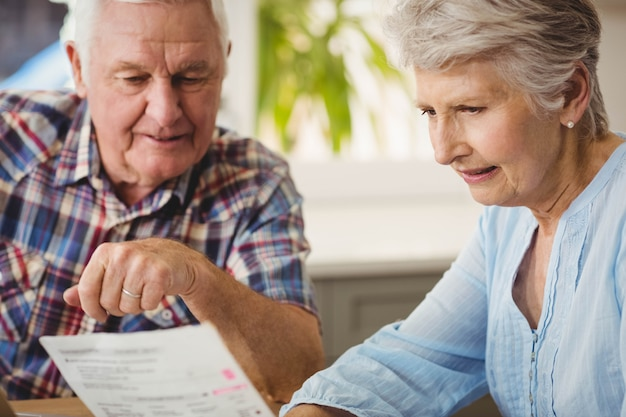 Senior couple discussing their bills at home